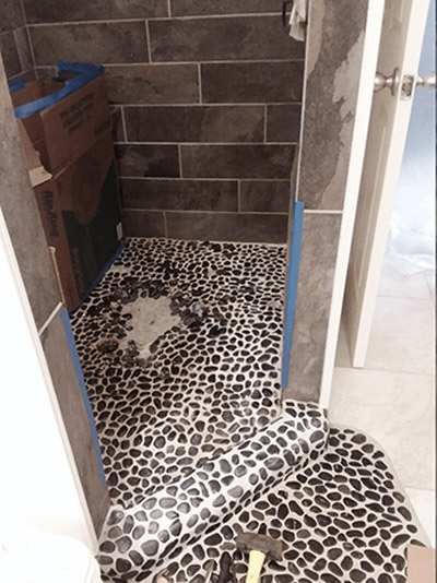 River Rock Tile Installation in bathroom completed by Acorn Maintenance Repair in Eagle River AK